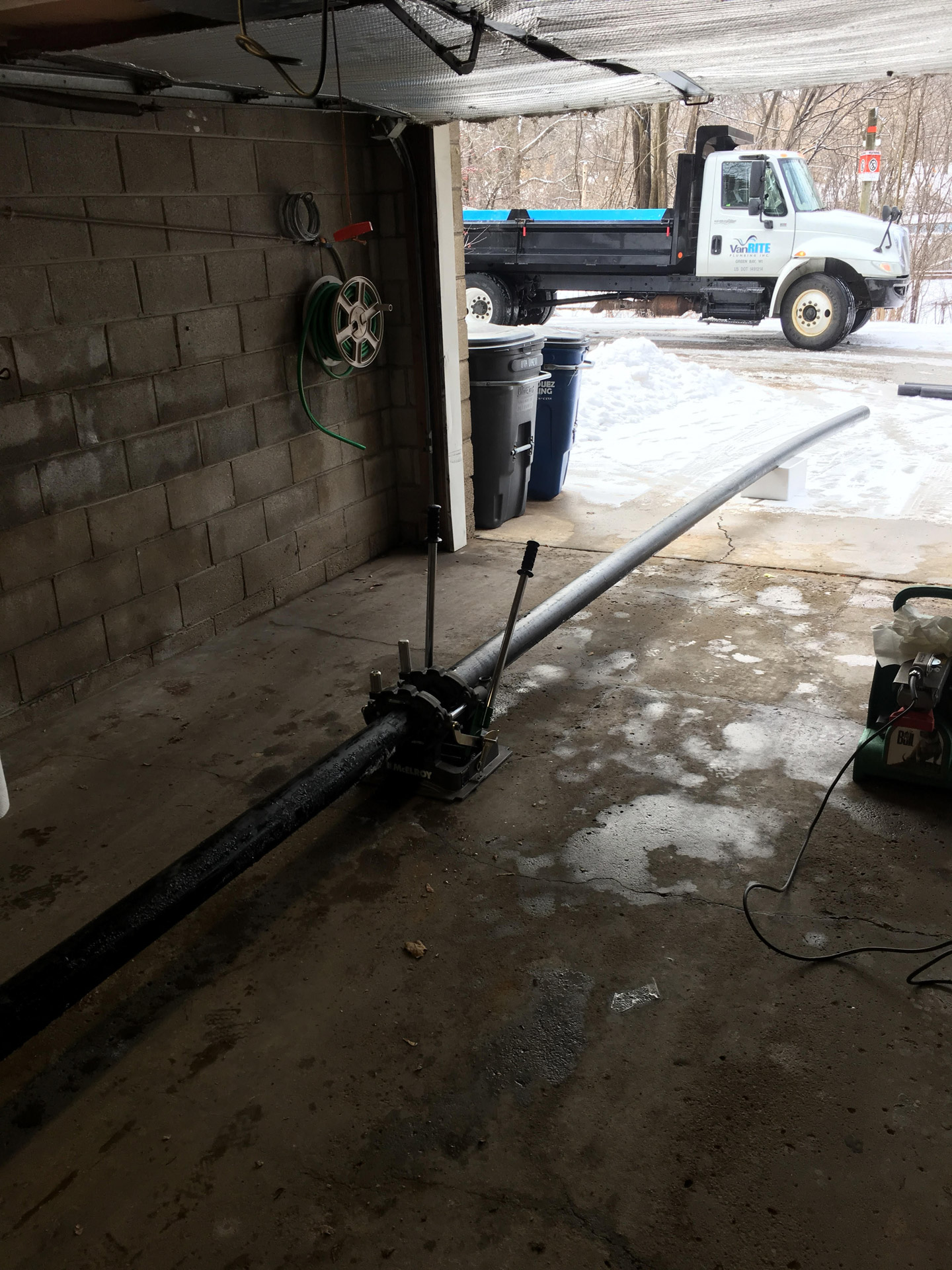 Sewer Pipe Staging in the Customer's Garage